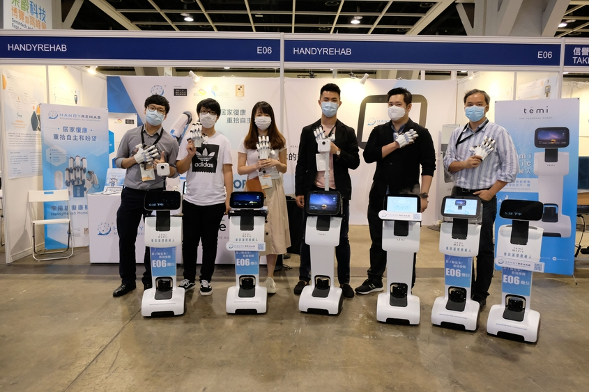 Photo: Zunosaki staff showing off HandyRehab smart robotic glove system and Temi Medic at Gerontech and Innovation Expo cum Summit 2020